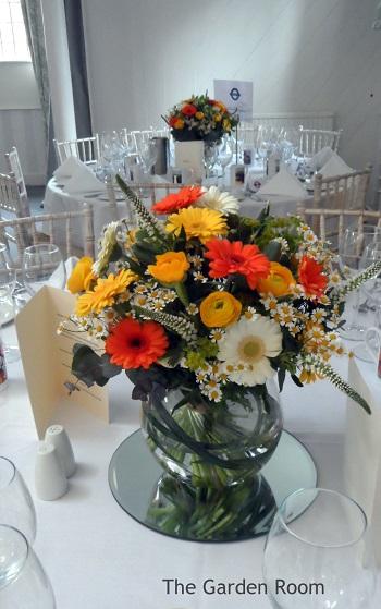 yellow and orange wedding flower arrangements