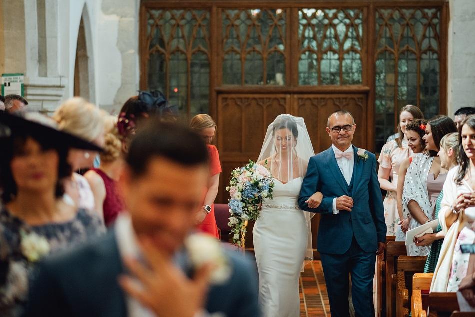 Dad and the bride enter