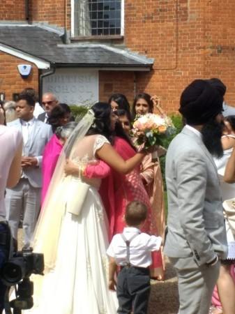 Family hugging outside the Kings Chapel
